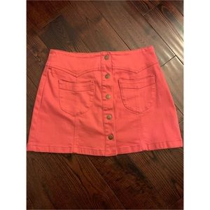 Pink button front mini skirt